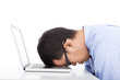 young businessman too overwork to asleep