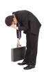 afflictive businessman stoop and hold his head