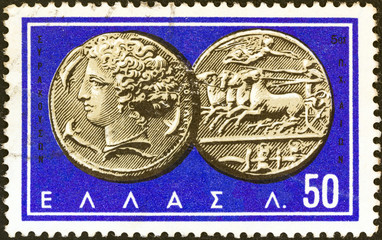 Coin from Syracuse, Arethusa and chariot (Greece 1963)