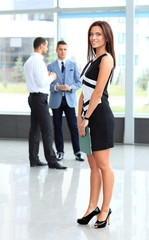 beautiful woman on the background of business people