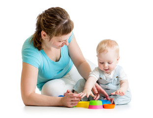 kid boy and mother play with toys