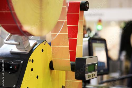 Leinwandbild Motiv Llabeling machine