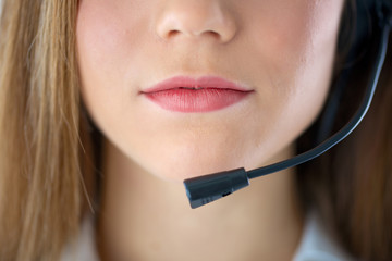 woman mouth speaking in headset
