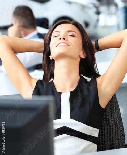 Portrait of an elegant cheerfu woman relaxing in office