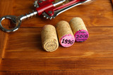 Wine corks with corkscrew on wine boxes close-up