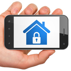 Finance concept: Home on smartphone