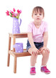 Beautiful little girl sitting on small ladder isolated on white