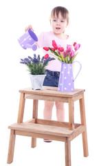 Beautiful little girl and stand with flowers isolated on white