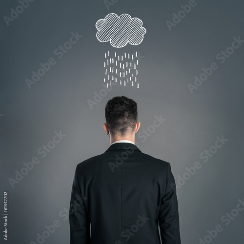 Businessman back view isolated on dark background with cloud ove