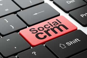 Business concept: Social CRM on computer keyboard background