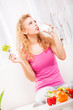 Beautiful woman drink yogurt and holding salad.