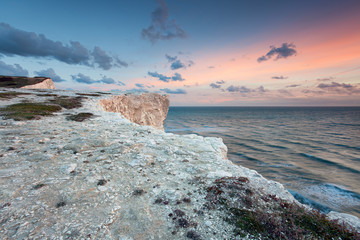 Pastel sunset over white sea cliffs
