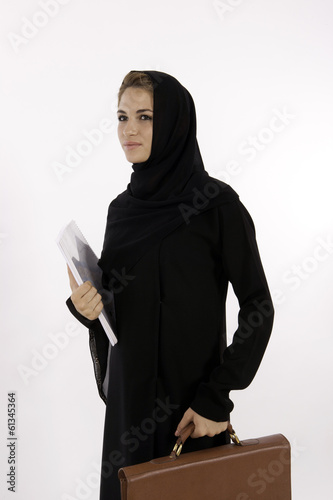 A Young Arab Woman Teacher Going To Work