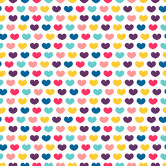 Seamless pattern with little colorful hearts