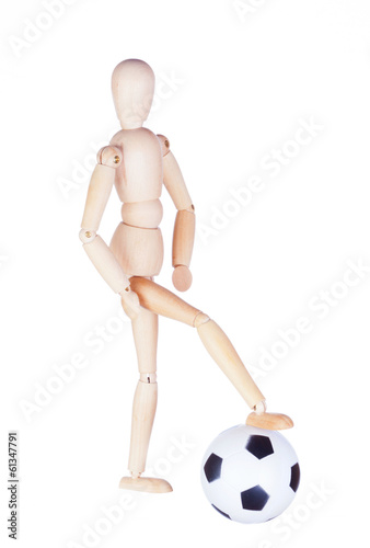Wooden figure of the little man with a soccerball
