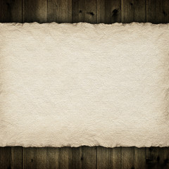 Handmade paper sheet on wooden planks background