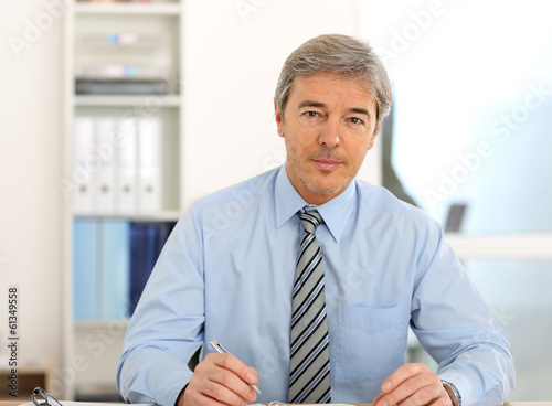 Portrait of mature businessman in office