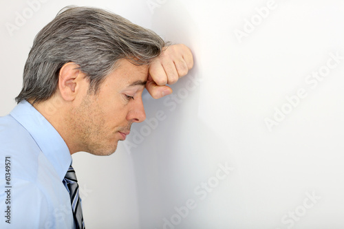 Portrait of mature depressed businessman, isolated