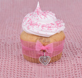 Cupcake with heart and ribbon