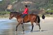 Mit Pferd am Strand