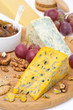 cheeses with mold, grapes, crackers, jam and nuts