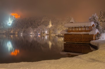 Bank of Lake Bled in Winter snowy foggy night