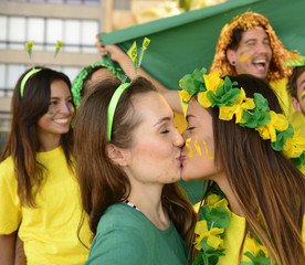 Brazilian girlfriends soccer fans kissing each.