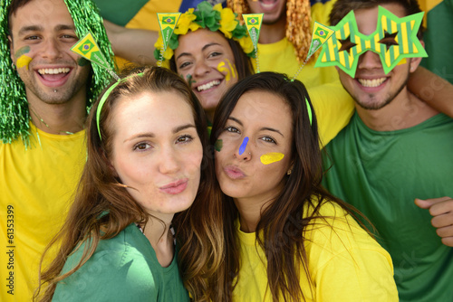 Brazilian soccer fans commemorating victory kissing.