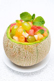 fruit salad in melon, close-up