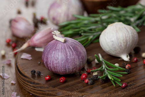 garlic, rosemary, sea salt and spices on wooden board