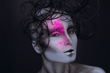 Sexy adult female with neon powred on face
