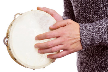 man playing a tambourine