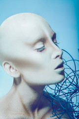 Bald woman with closed eyes in studio