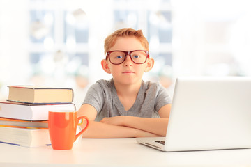 Young student sitting at desk