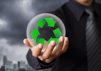 Business people holding recycle sign in crystal ball