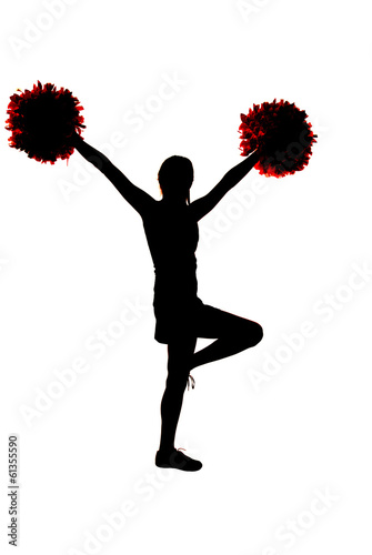 canvas print picture Young girl cheerleader silhouette with hands in the air