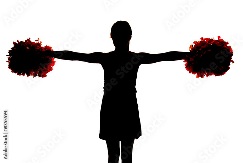 silhouette of a young cheerleader holding her pompoms straight o