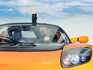 Woman shows thumb up for driving enjoyment