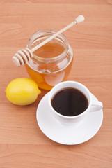 Fresh lemon, tea and honey jar.