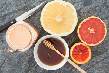 Fresh grapefruit and juice served with honey