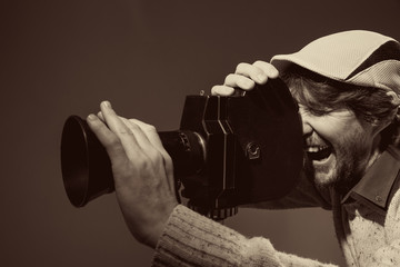 Man with retro camera. cinema operator