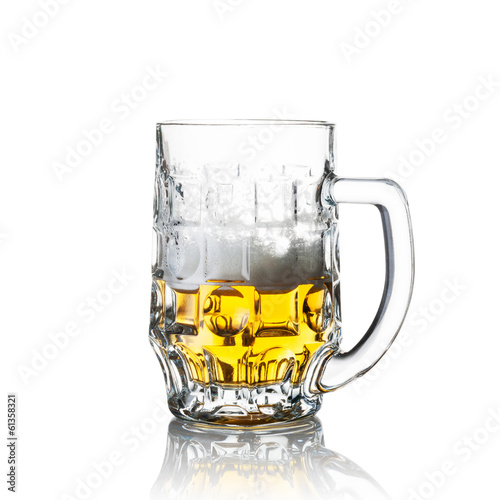 Half a glass of beer isolated on white
