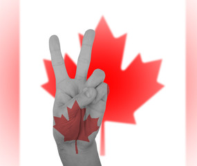 Hand peace sign with flag of Canada