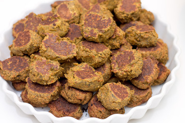 Heap of falafels in large white bowl