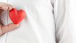 Man holding a red heart