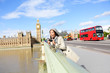 London travel woman tourist by Big Ben and red bus