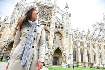 Westminster Abbey church London with young woman