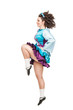 Woman in irish dance dress dancing isolated