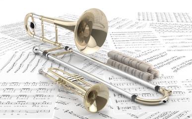Trombón y Trompeta sobre partituras.