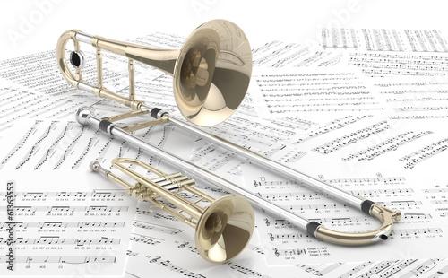 Leinwanddruck Bild Trombón y Trompeta sobre partituras 2